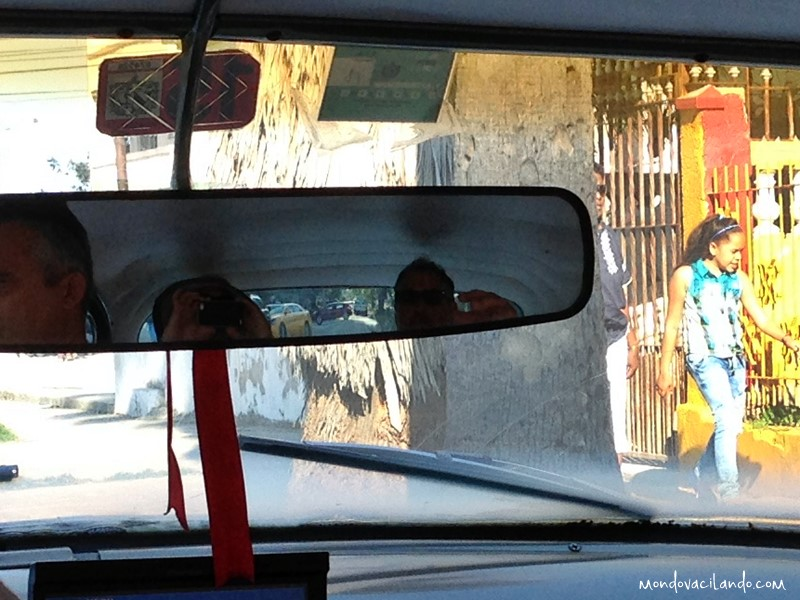 Riding in one of the old car cabs in Havana, Cuba