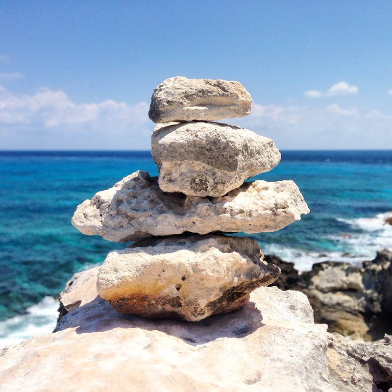 Cairn, or stacked rocks at Punta Sur, Isla Mujeres, Mexico